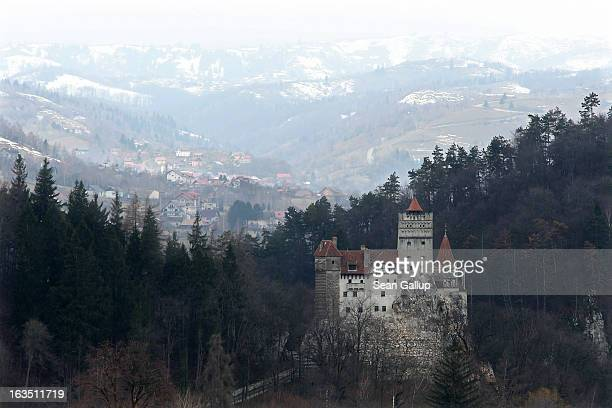 Bran Castle famous as Dracula's Castle stands among Transylvanian mountains on March 10 2013 in Bran Romania Bran Castle's reputation as the supposed...