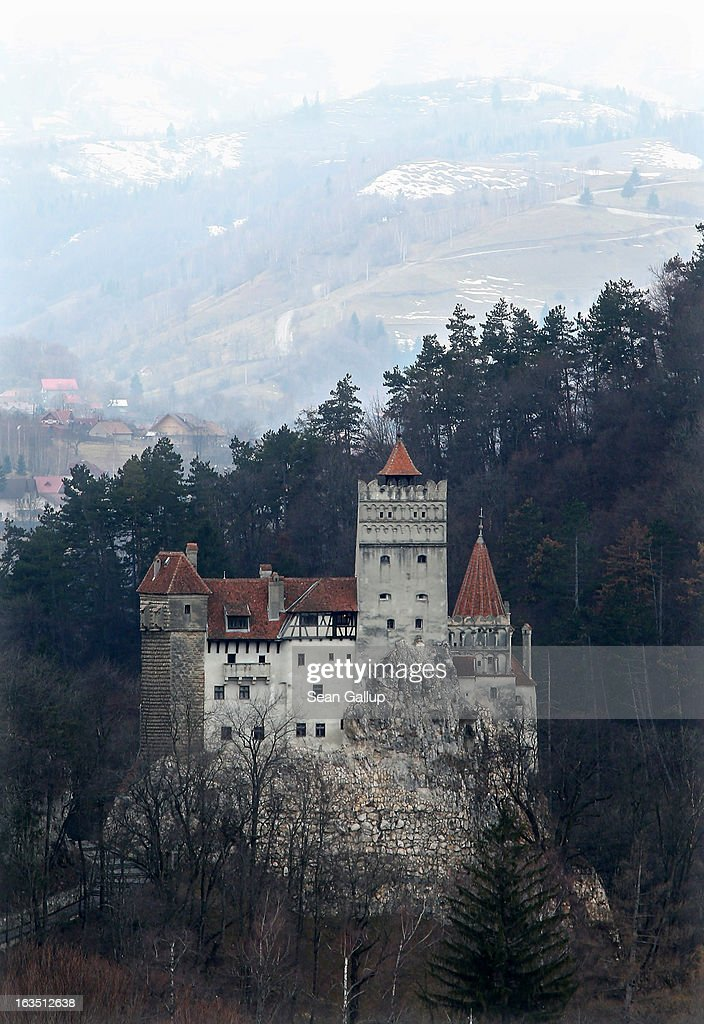 Bran Castle, famous as 'Dracula's Castle,' stands among Transylvanian mountains on March 10, 2013 in Bran, Romania. Bran Castle's reputation as the supposed home to Dracula corresponds little with Bram Stoker's novel, nor did Vlad Tepes, the sadistic 15th-century Wallachian prince, ever live there. Nevetheless the castle retains the myth and tourists flock there in large numbers. Bran Castle, along with the mountainous region of southern Transylvania, which is home to Saxon fortified towns and churches, are among the asssets the Romanian government hopes will bring increasing numbers of tourists to the country. Both Romania and Bulgaria have been members of the European Union since 2007 and restrictions on their citizens' right to work within the EU are scheduled to end by the end of this year. However Germany's interior minister announced recently that he would veto the two countries' entry into the Schengen Agreement, which would not affect labour rights but would prevent passport-free travel.