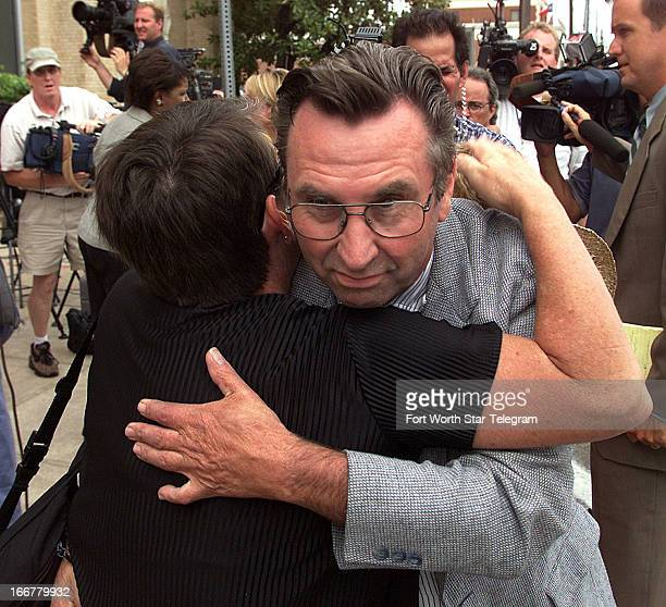 Branch Davidian Clive Doyle is greeted by Mary Aleshire after leaving federal court in Waco Texas July 14 2000 Doyle survived but lost a daughter...