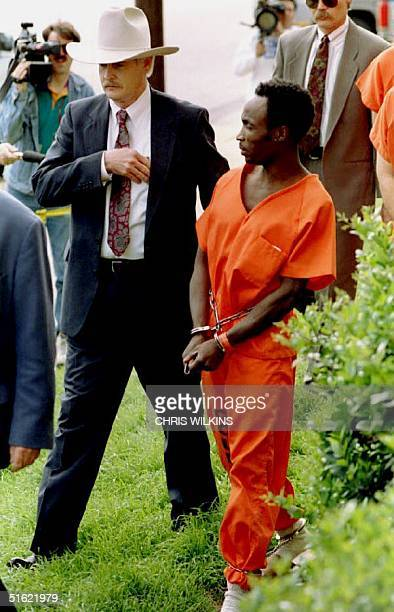 Branch Davidian cult member Livingston Fagan of Great Britain is escorted into the federal courthouse 24 March 1993 for an initial hearing after...