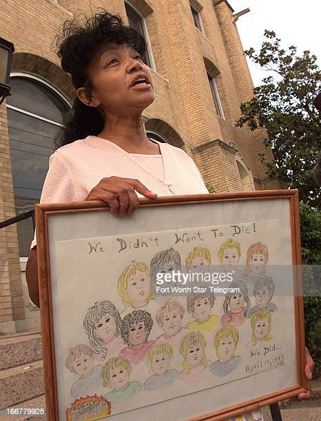 Branch Davidian Sheila Martin holds a picture of children who died at Mount Carmel outside federal court in Waco Texas July 14 2000 Martin lost a...