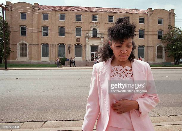 Branch Davidian survivor Sheila Martin walks away from the federal courthouse in Waco Texas during a break in the morning proceedings June 19 2000...