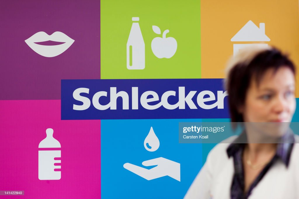 A branch manager pass the new logo of the Schlecker brand at a Schlecker drugstore on March 16, 2012 in Strausberg, Germany. The German drugstore chain released a list of 2,010 stores in Germany that it will close out of a total of 5,400, which is less than originally predicted. Schlecker hopes to return to profitability with modern, well-placed stores like the one in Strausberg, which is not slated for closure.