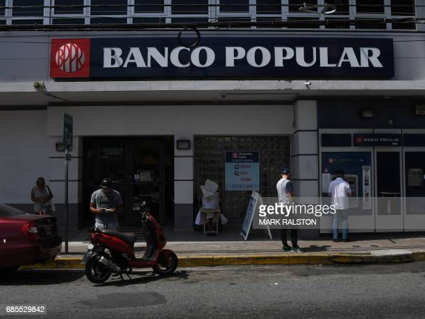 A branch of the Banco Popular is pictured on May 17 2017 in San Juan Puerto Rico as the former Spanish colony of 35 million now a US territory...