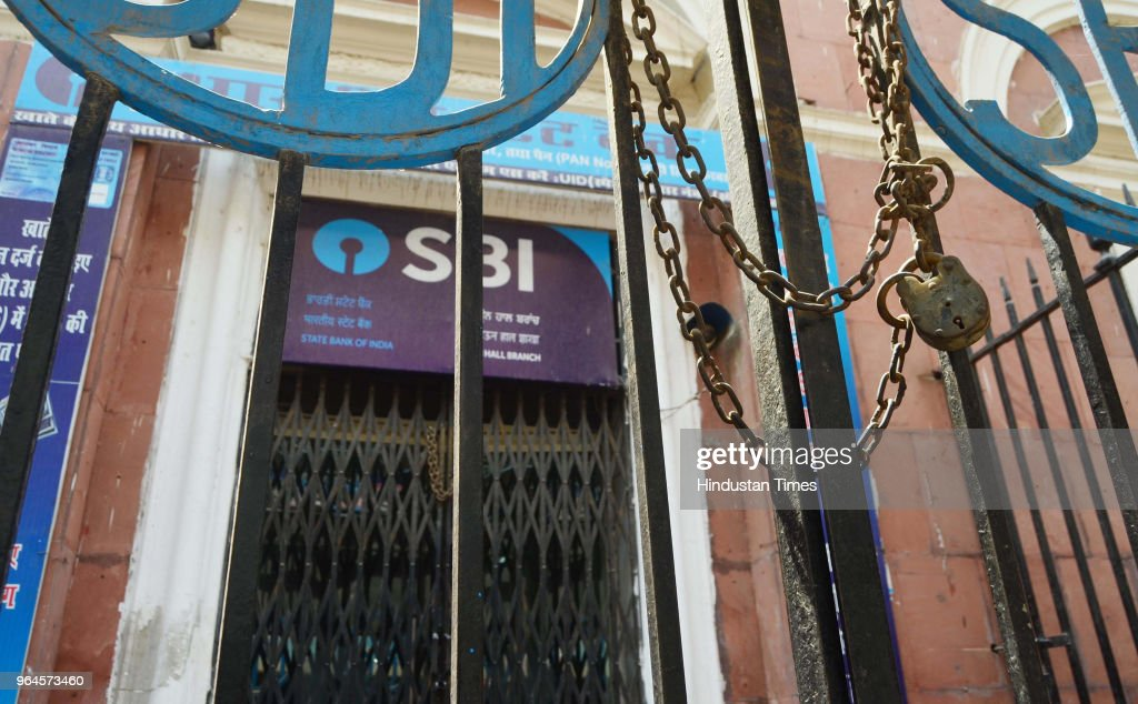 A branch of the State Bank of India the country`s biggest bank is locked and closed for business as over a million employees of India`s stateowned...