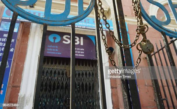 Branch of the State Bank of India , the country's biggest bank, is locked and closed for business, as over a million employees of India's state-owned...