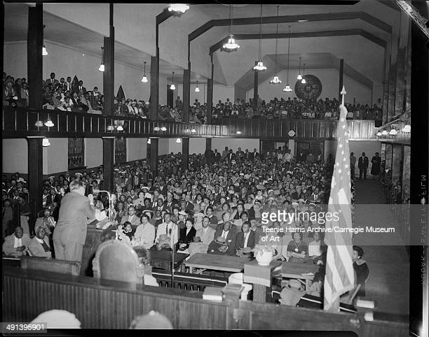 Branch Rickey introducing Jackie Robinson to crowd in Wesley Center AME Zion Church for NAACP fundraiser '1957 Fight for Freedom Fund,' Pittsburgh,...