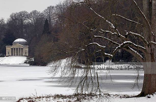 Branches from a tree fall to the frozen lake at the National Trust's Stourhead near Warminster on January 12 2010 in Wiltshire England Much of UK is...