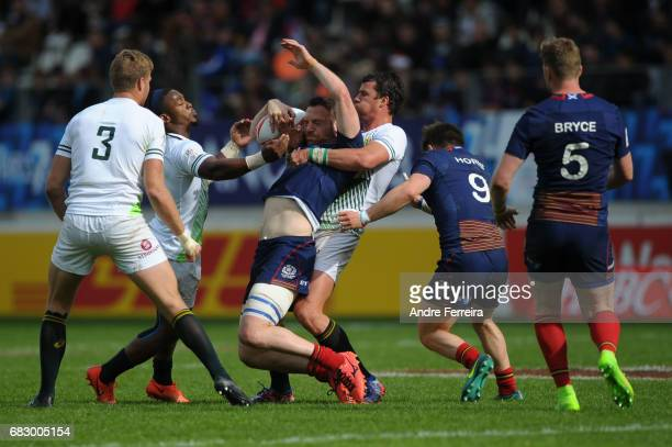 Branco du Preez of South Africa and Jamie Farndale of Scotland and Ruhan Nel of South Africa during the final match between Scotland and South Africa...