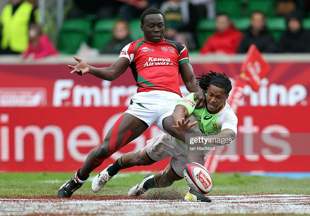 Branco du Preez of South Africa dives on a loose ball during the South Africa and Kenya match during day two of the IRB Glasgow Sevens at Scotstoun Stadium on May 4, 2014 in Glasgow, Scotland.