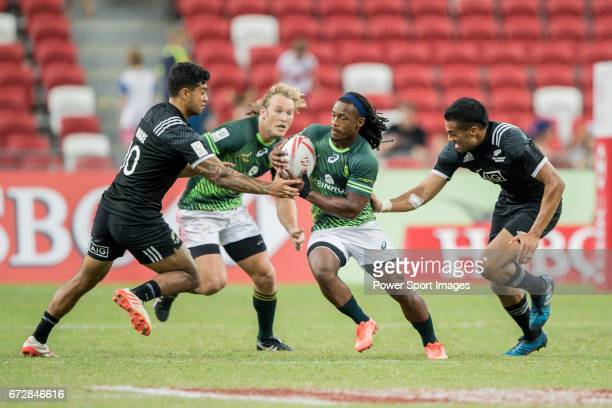 Branco Du Preez of South Africa runs with the ball while New Zealand's players including Sione Molia try to stop him during the match South Africa vs...