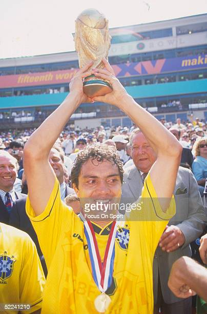 July 19: Branco of Brazil holds the Jules Rimet Trophy after defeating Italy for the 1994 World Cup at the Rose Bowl on July 19, 1994 in Pasadena,...