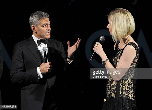 Brand Ambassador George Clooney and writer Lily Koppel speak onstage during the OMEGA Speedmaster Houston Event at Western Airways Airport Hangar on...