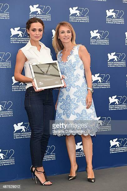 Brand director of L'Oreal Paris Italia Stefania Fabiano poses with winner Valeria Bilello at a photocall for L'Oreal Paris Award For Cinema during...
