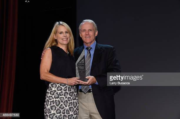 Brand Distribution Turner Broadcasting System Inc. And WICT Woman to Watch award winner Jennifer Mirgorod accepts the WICT Woman to Watch award from...