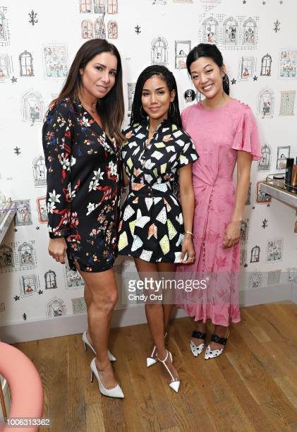 Brand Group President Tammy Brook singer/ songwriter Jhene Aiko and Allure Editor in Chief Michelle Lee pose for a photo at the Jhene Aiko Trip Film...