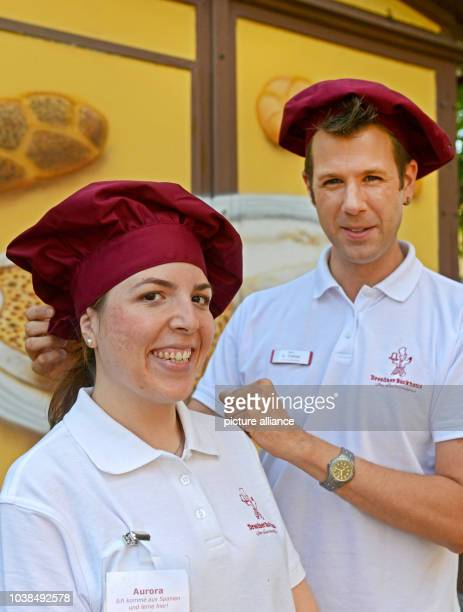 Brand manager Oliver Tietze presents the new Spanish trainee Aurora Madrd in the bakehouse in Dresden Germany 21 August 2014 The trainee is benefited...