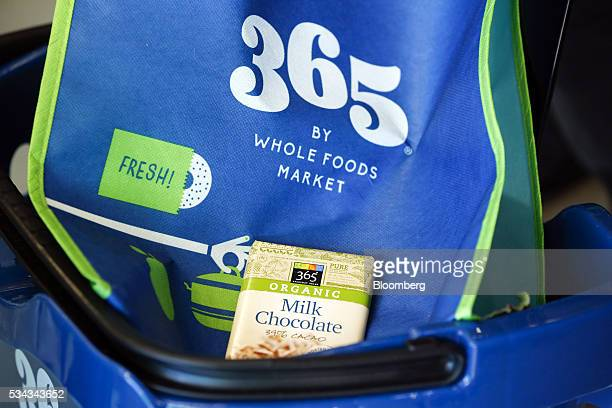 A 365 brand milk chocolate bar sits in a shopping cart on the opening day of the 365 by Whole Foods Market store in the Silver Lake neighborhood of...