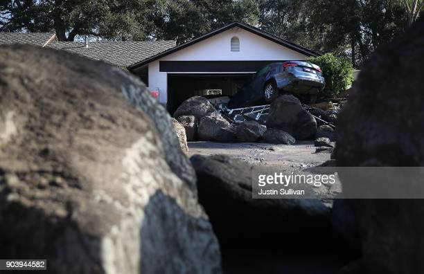 A brand new car sits on top of boulders in the driveway of a home that was destroyed by a mudslide on January 11 2018 in Montecito California 17...