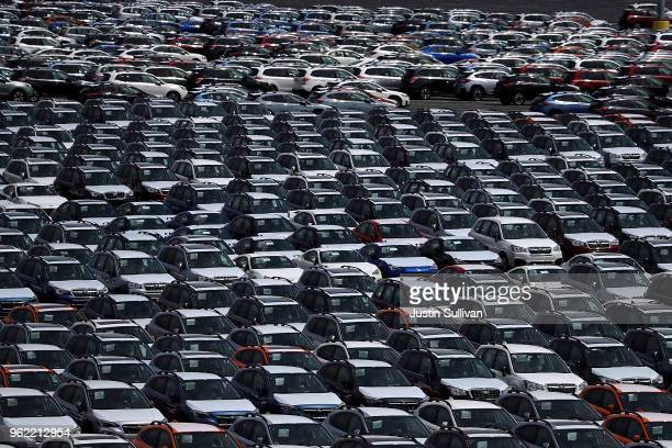 Brand new cars sit in a lot at the Auto Warehousing Company near the Port of Richmond on May 24 2018 in Richmond California US president Donald Trump...