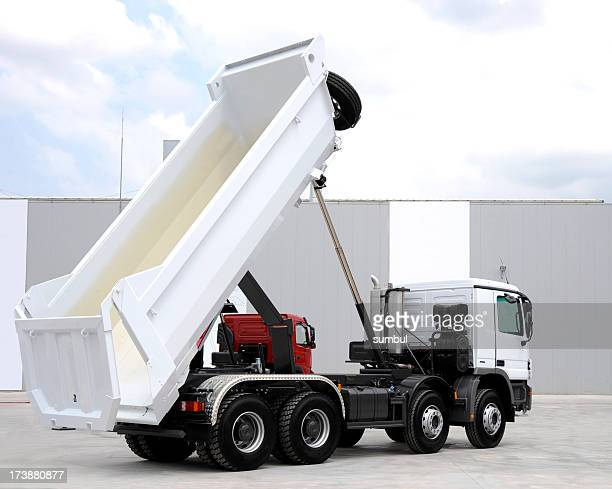 A brand new dump truck lifted up for view