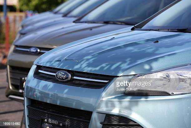 Brand new Ford Escape SUVs are displayed on the sales lot at Journey Ford on June 4 2013 in Novato California Ford announced the recall of over...