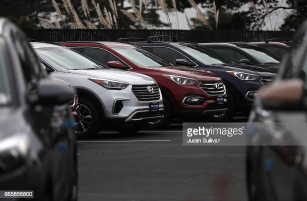 Brand new Hyundai Santa Fe SUVs are displayed at a Hyundai dealership on April 7, 2017 in Colma, California. South Korean automakers Kia and Hyundai...