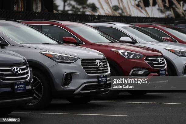 Brand new Hyundai Santa Fe SUVs are displayed at a Hyundai dealership on April 7 2017 in Colma California South Korean automakers Kia and Hyundai...
