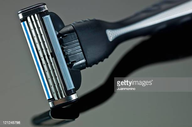 brand new male razor gray and blue color - razor stock photos and pictures