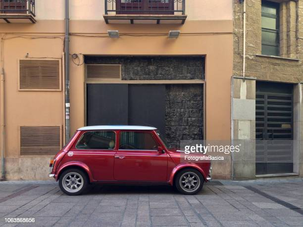 brand new mini cooper parked in pedestrian walkway - mini cooper stock pictures, royalty-free photos & images