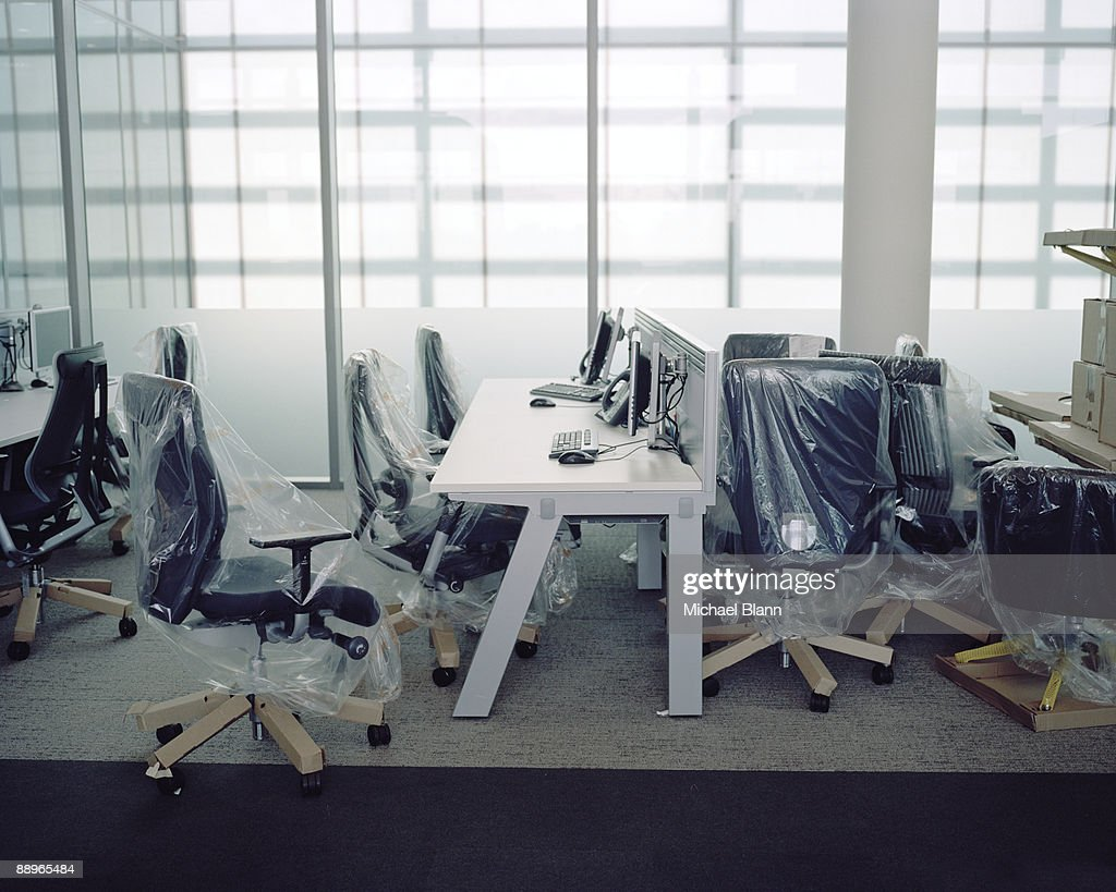 Brand New Office Furniture With Plastic Wrap Stock Photo