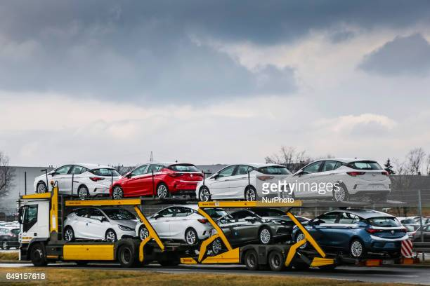 A brand new Opel Astra vehicles are transported by a car carrier trailer as they leave the Opel car factory of General Motors Manufacturing Poland in...