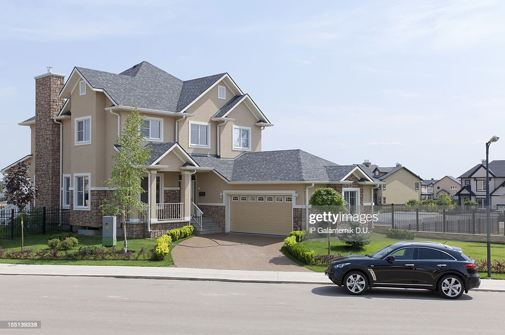 Brand new suburban house in sunny summer afternoon. : Stock Photo