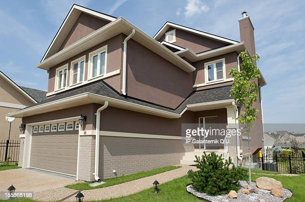brand new suburban house in sunny summer afternoon - borough district type stock pictures, royalty-free photos & images