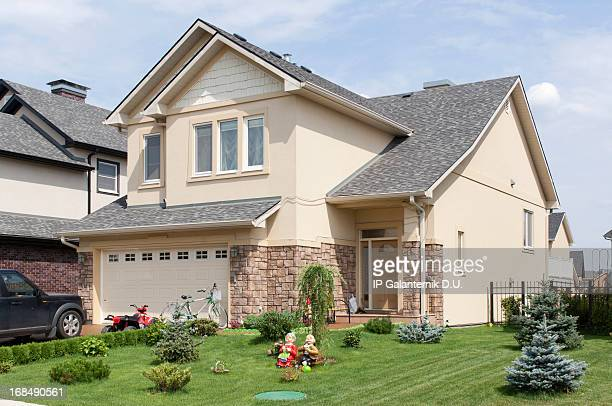 brand new suburban house in sunny summer afternoon. - borough district type stock pictures, royalty-free photos & images