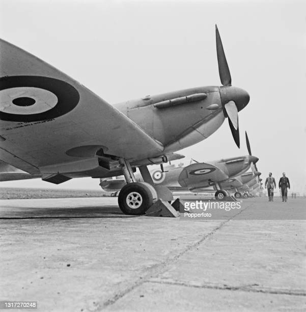 Brand new Supermarine Spitfire Mk II fighter aircraft lined up on a concrete apron at an aircraft factory in England during World War II on 2nd April...
