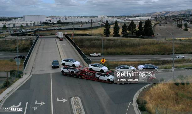 Brand new Tesla cars leave the Tesla Fremont Factory on a truck on May 13 2020 in Fremont California Days after Alameda County ordered Tesla's CEO...