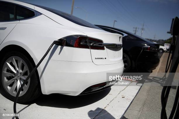 Brand new Tesla Model S cars sit on front of a Tesla showroom on August 2 2017 in Corte Madera California Tesla will report secondquarter earnings...