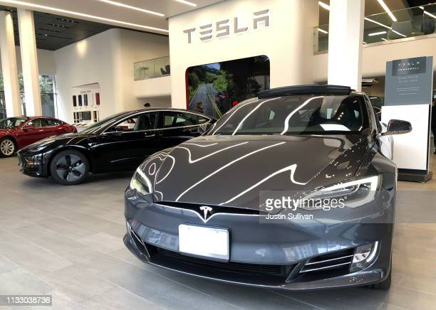 Brand new Tesla vehicles are displayed at a Tesla showroom on March 01 2019 in San Francisco California Tesla announced plans to shutter almost all...