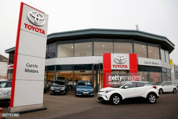 Brand new Toyota cars sit on the forecourt of Currie Motors Toyota dealership in Twickenham west London on January 26 2017 Britain's car industry...