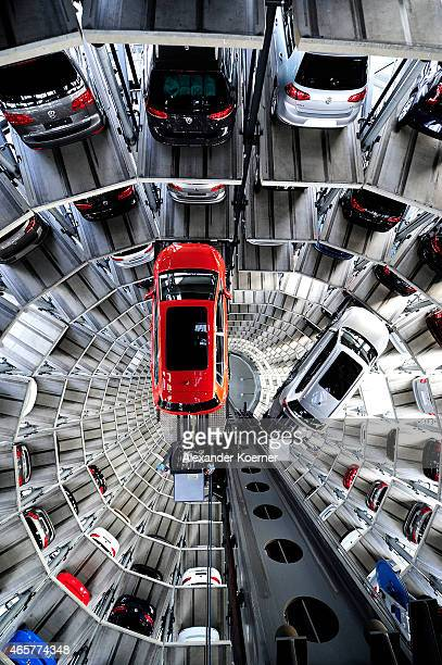 A brand new Volkswagen Passat and Golf 7 car are stored in a tower at the Volkswagen Autostadt complex near the Volkswagen factory on March 10 2015...