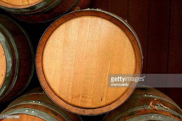 Brand new wine barrel sitting on top of other barrels