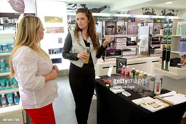 Brand representative speaks with guest Sephora VIB Rouge Spring Social at Sephora Santa Monica on March 30 2014 in Santa Monica California