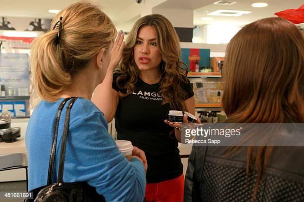 Brand representative speaks with guests Sephora VIB Rouge Spring Social at Sephora Santa Monica on March 30 2014 in Santa Monica California