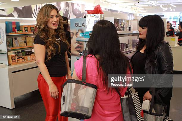 Brand representative with guests at the Sephora VIB Rouge Spring Social at Sephora Santa Monica on March 30 2014 in Santa Monica California
