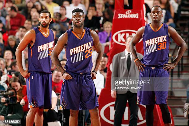 Brandan Wright Earl Barron and Reggie Bullock of the Phoenix Suns during the game against the Portland Trail Blazers on March 30 2015 at Moda Center...