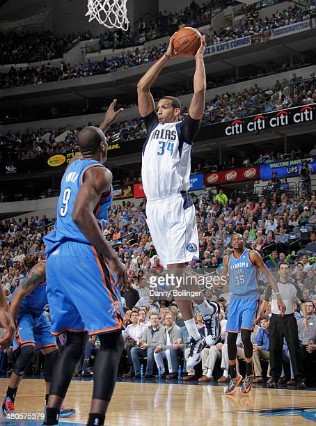 Brandan Wright of the Dallas Mavericks grabs a rebound against Serge Ibaka of the Oklahoma City Thunder on March 25 2014 at the American Airlines...