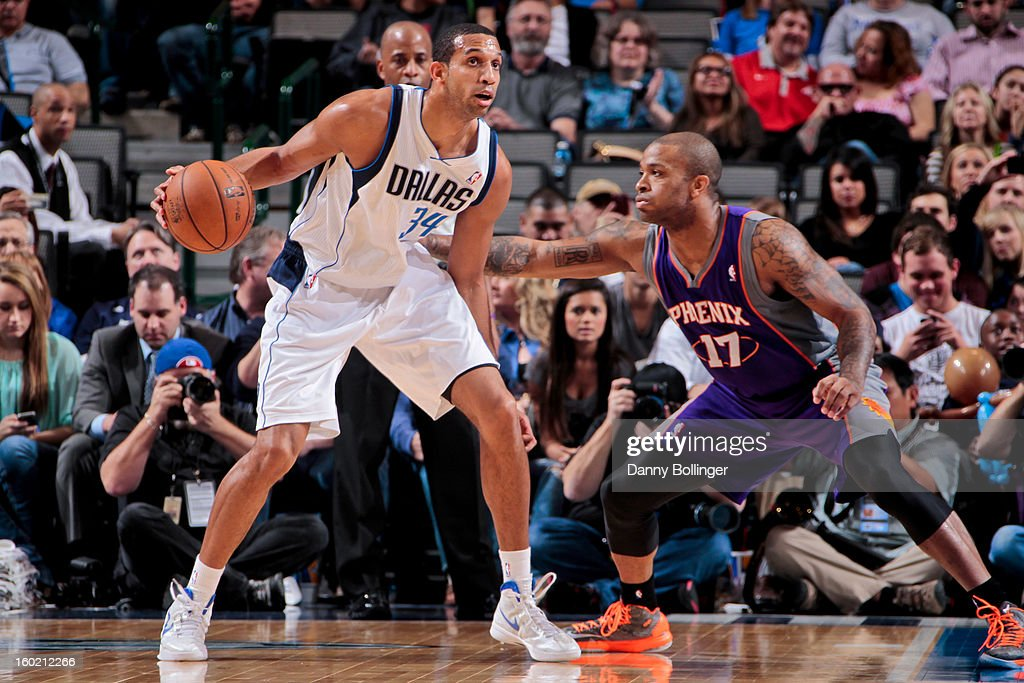 Brandan Wright #34 of the Dallas Mavericks posts up against P.J. Tucker #17 of the Phoenix Suns on January 27, 2013 at the American Airlines Center in Dallas, Texas.