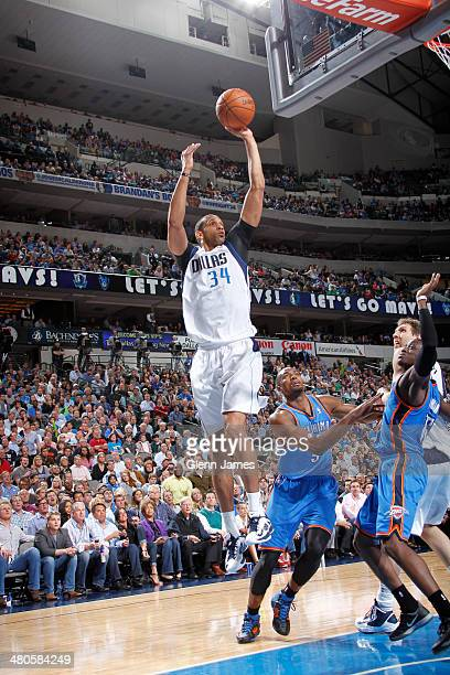 Brandan Wright of the Dallas Mavericks shoots a jumper against Serge Ibaka of the Oklahoma City Thunder on March 25 2014 at the American Airlines...