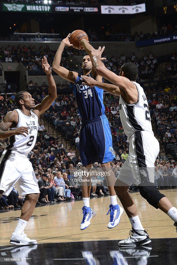 Brandan Wright #34 of the Dallas Mavericks shoots against the San Antonio Spurs on March 14, 2013 at the AT&T Center in San Antonio, Texas.